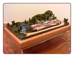 "Miniature Train Layout - 4""x7"" Oval with Old West Town"